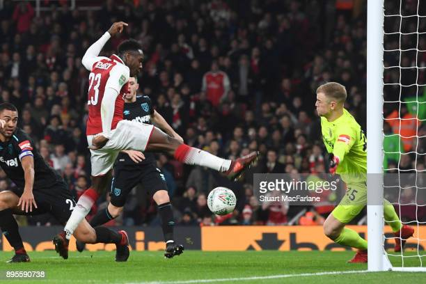 Danny Welbeck shoots past West Ham goalkeeper Joe Hart to score for Arsenal during the Carabao Cup Quarter Final match between Arsenal and West Ham...