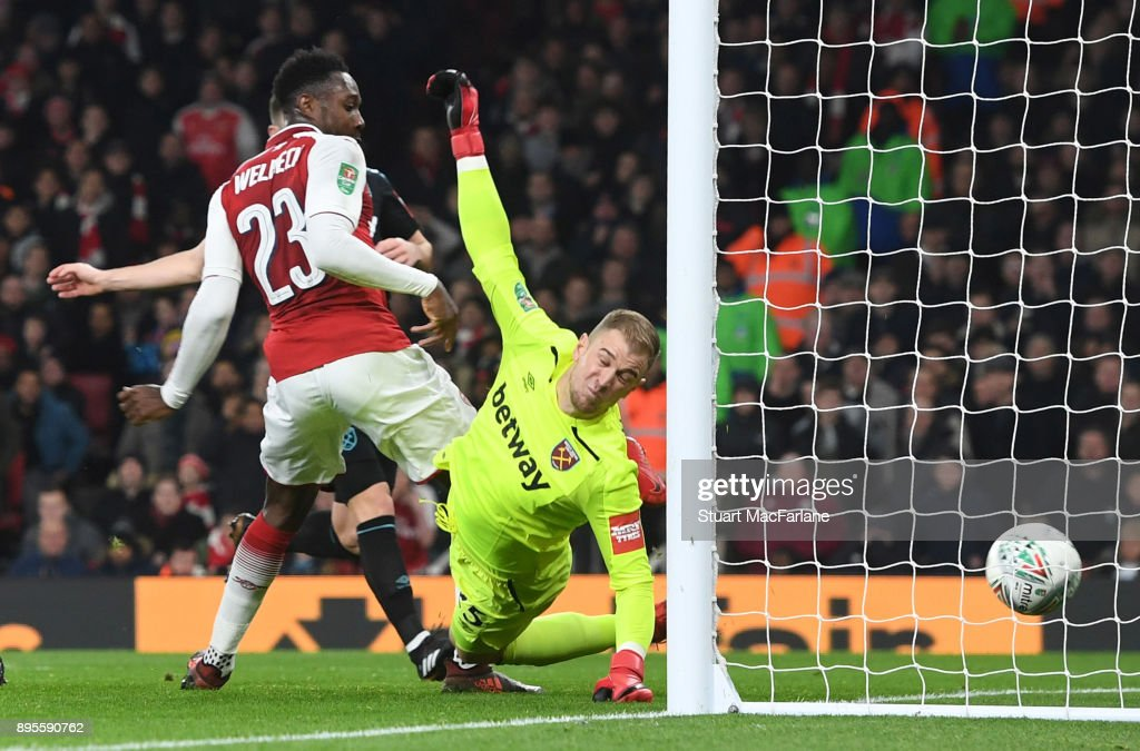 Danny Welbeck shoots past West Ham goalkeeper Joe Hart to score for Arsenal during the Carabao Cup Quarter Final match between Arsenal and West Ham United at Emirates Stadium on December 19, 2017 in London, England.