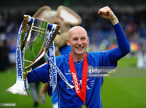 Danny Whitaker of Chesterfield celebrates with the trophy after being crowned Champions during the npower League Two match between Chesterfield and...