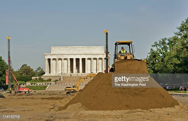 Danny White maneuvers his track loader on a mound of earth as construction on the new Lincoln Memorial Reflecting Pool project continues in...