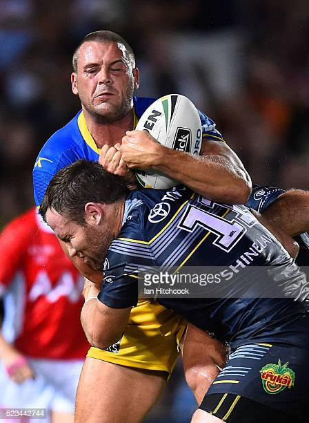 Danny Wicks of the Eels is tackled by Gavin Cooper of the Cowboys during the round eight NRL match between the North Queensland Cowboys and the...