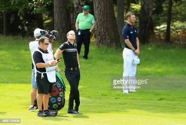 Danny Willett and Chris Wood of England observe a minutes silence on the 12th hole during day one of the BMW PGA Championship at Wentworth on May 25,...
