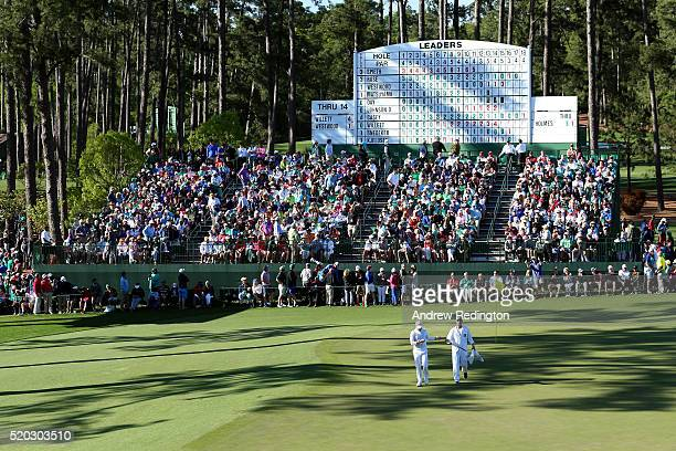 Danny Willett of England and caddie Jonathan Smart walk on the 15th hole during the final round of the 2016 Masters Tournament at Augusta National...