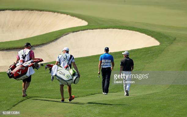 Danny Willett of England and Henrik Stenson of Sweden the leading two players in the European Tour Race to Dubai lead their caddies to the fourth...