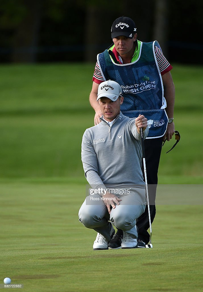 Danny Willett of England and his caddie Jonathan Smart line up a putt during the first round of the Dubai Duty Free Irish Open Hosted by the Rory Foundation at The K Club on May 19, 2016 in Straffan, Ireland.
