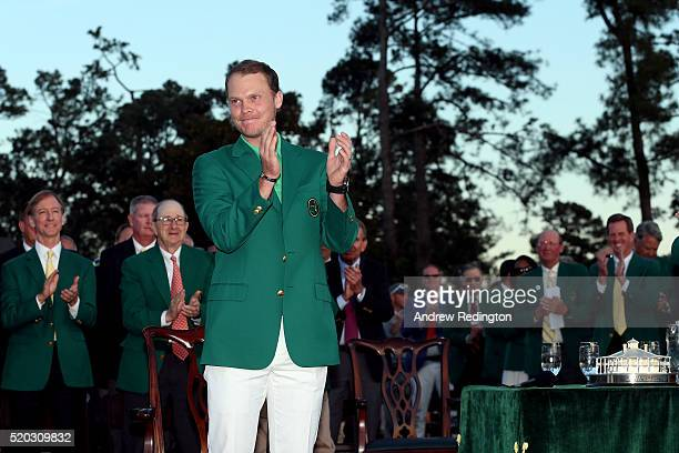 Danny Willett of England celebrates after being presented with the green jacket for winning the final round of the 2016 Masters Tournament at Augusta...
