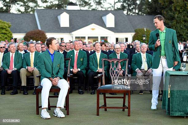 Danny Willett of England celebrates during the green jacket ceremony with Jordan Spieth of the United States after winning the 2016 Masters...