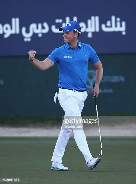Danny Willett of England celebrates his victory on the 18th green during the final round of the Omega Dubai Desert Classic at the Emirates Golf Club...