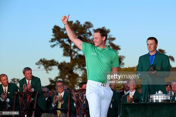 Danny Willett of England celebrates winning during the green jacket ceremony with Jordan Spieth of the United States during the final round of the...