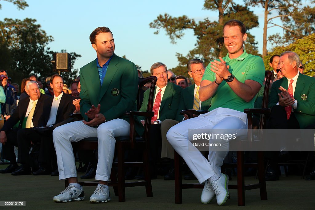 Danny Willett of England celebrates winning during the green jacket ceremony with Jordan Spieth of the United States after the final round of the 2016 Masters Tournament at Augusta National Golf Club on April 10, 2016 in Augusta, Georgia.