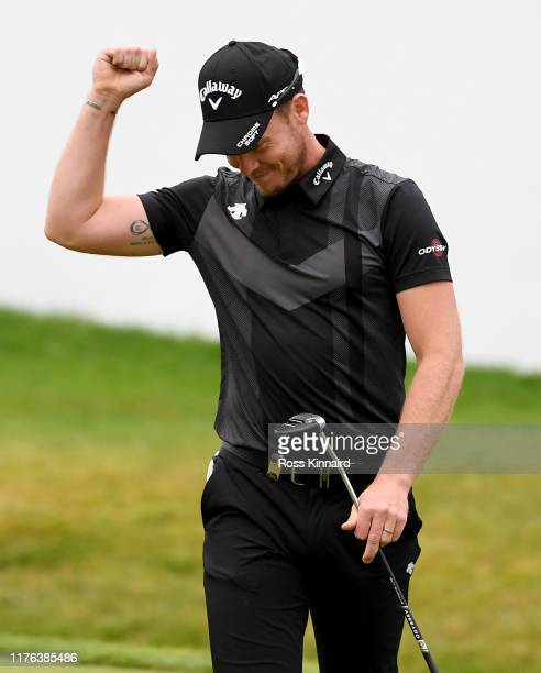 Danny Willett of England celebrates winning the BMW Championship during the final round of of the BMW PGA Championship at Wentworth Golf Club on...
