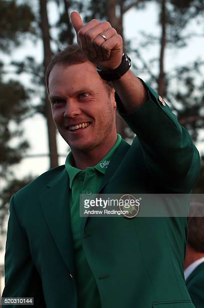 Danny Willett of England celebrates with the green jacket after winning the final round of the 2016 Masters Tournament at Augusta National Golf Club...