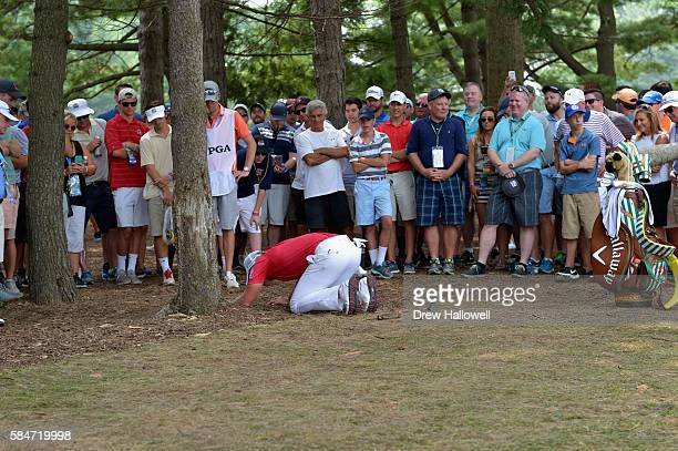 Danny Willett of England checks the placement of his ball on the 18th hole during the third round of the 2016 PGA Championship at Baltusrol Golf Club...