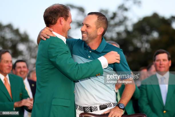 Danny Willett of England congratulates Sergio Garcia of Spain during the Green Jacket ceremony after Garcia won in a playoff during the final round...