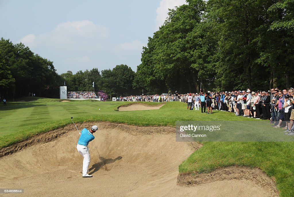 Danny Willett of England hits from a bunker on the 16th hole during day three of the BMW PGA Championship at Wentworth on May 28, 2016 in Virginia Water, England.