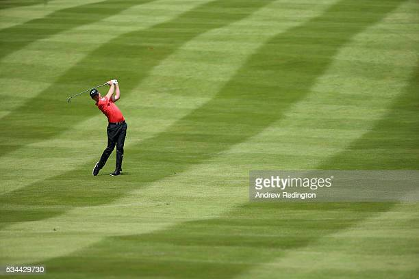 Danny Willett of England hits his 2nd shot on the 4th hole during day one of the BMW PGA Championship at Wentworth on May 26 2016 in Virginia Water...