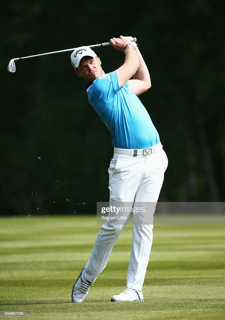 Danny Willett of England hits his 2nd shot on the 9th hole during day three of the BMW PGA Championship at Wentworth on May 28, 2016 in Virginia Water, England.
