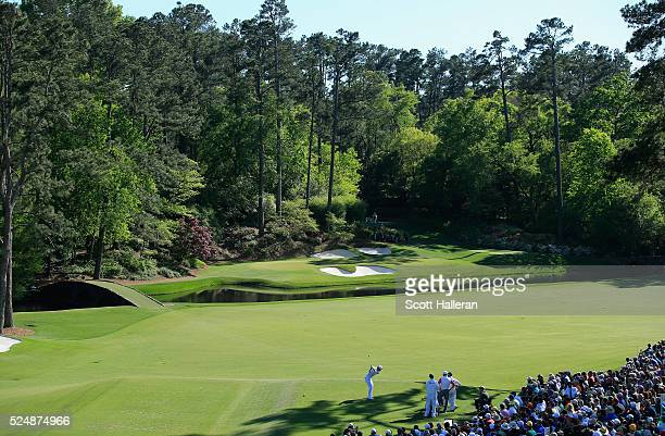 Danny Willett of England hits his tee shot on the 12th hole during the final round of the 2016 Masters Tournament at the Augusta National Golf Club...