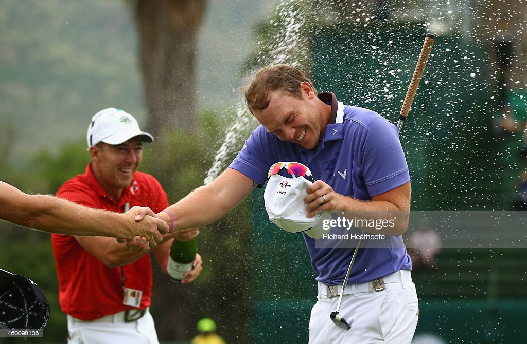Danny Willett of England is sprayed with champagne as he celebrates victory during the final round of the Nedbank Golf Challenge at the Gary Player Country Club on December 7, 2014 in Sun City, South Africa.