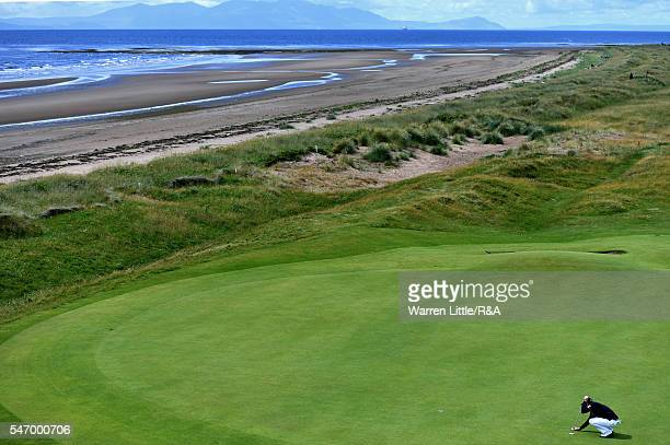 Danny Willett of England lines up a putt on the 5th green during previews to the 145th Open Championship at Royal Troon on July 13 2016 in Troon...