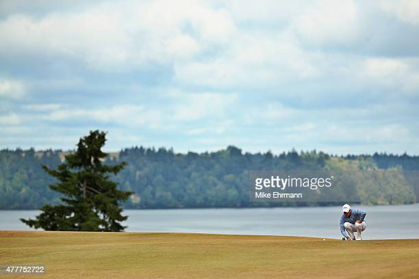 Danny Willett of England lines up a putt on the fifth hole during the second round of the 115th US Open Championship at Chambers Bay on June 19 2015...