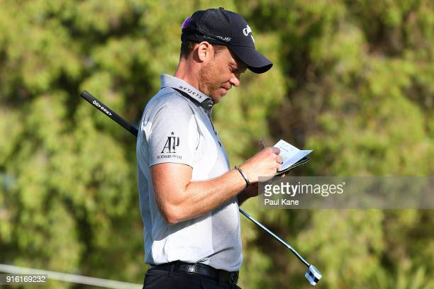 Danny Willett of England marks his score in his scorecard during day two of the World Super 6 at Lake Karrinyup Country Club on February 9 2018 in...