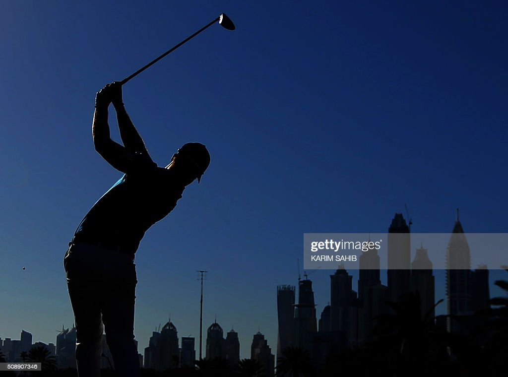 TOPSHOT - Danny Willett of England plays a shot during the 2016 Dubai Desert Classic at the Emirates Golf Club in Dubai on February 7, 2016. / AFP / KARIM