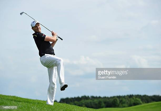 Danny Willett of England plays a shot during the third round of the BMW International Open at Gut Larchenhof golf club on June 23 2012 in Cologne...