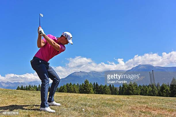 Danny Willett of England plays a shot on the 13th hole during the third round of the Omega European Masters at CranssurSierre Golf Club on July 25...