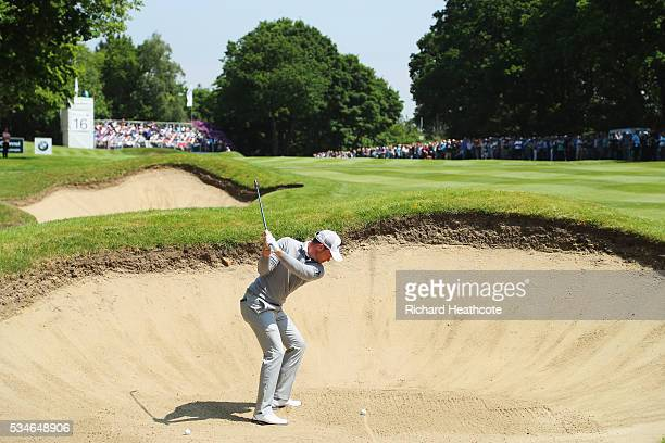 Danny Willett of England plays from a bunker on the 16th hole during day two of the BMW PGA Championship at Wentworth on May 27 2016 in Virginia...