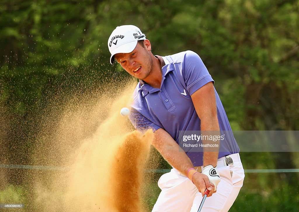 Danny Willett of England plays from a greenside bunker on the 12th during the final round of the Nedbank Golf Challenge at the Gary Player Country Club on December 7, 2014 in Sun City, South Africa.