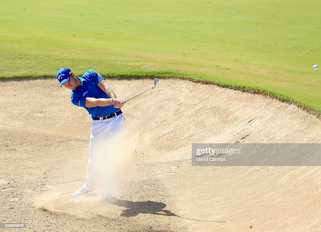 Danny Willett of England plays his second shot at the par 4, first hole during the final round of the 2016 Omega Dubai Desert Classic on the Majlis Course at the Emirates Golf Club on February 7, 2016 in Dubai, United Arab Emirates.