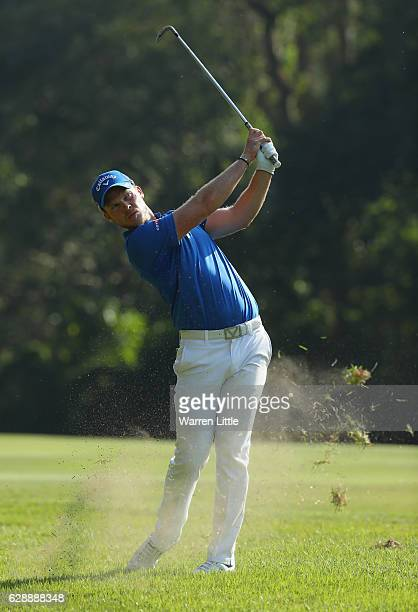 Danny Willett of England plays his second shot into the 11th green during the third round of the UBS Hong Kong Open at The Hong Kong Golf Club on...