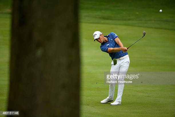 Danny Willett of England plays his second shot off the third fairway during the first round of the World Golf Championships Bridgestone Invitational...