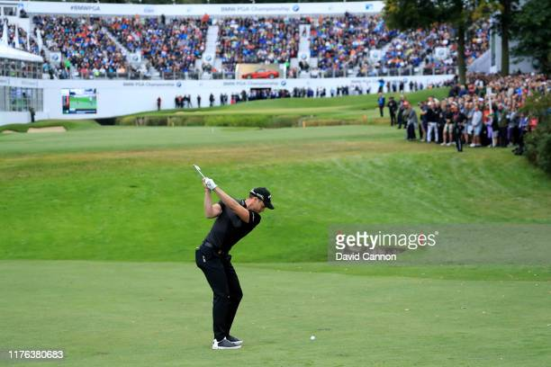Danny Willett of England plays his second shot on the 18th hole during the final round of the BMW PGA Championship on the West Course at the...