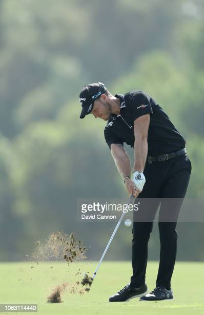 Danny Willett of England plays his second shot on the par 4, third hole during the final round of the DP World Tour Championship on the Earth Course...