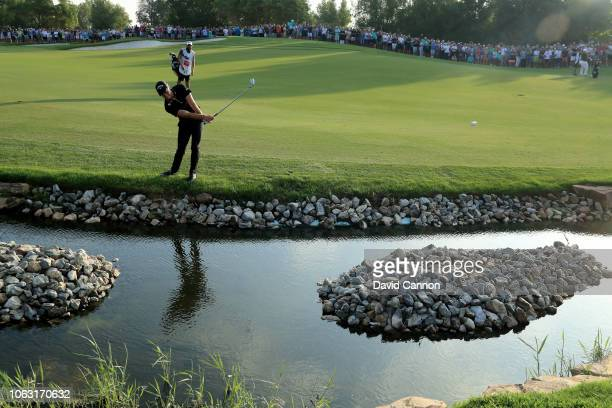 Danny Willett of England plays his second shot on the par 5 18th hole during the final round of the DP World Tour Championship on the Earth Course at...