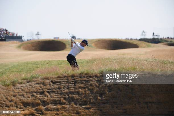 Danny Willett of England plays his second shot towards the Spectacles bunkers at the 14th hole during round one of the 147th Open Championship at...