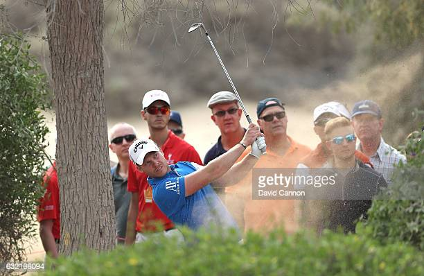 Danny Willett of England plays his third shot on the 13th hole during the second round of the Abu Dhabi HSBC Championship at the Abu Dhabi Golf Club...