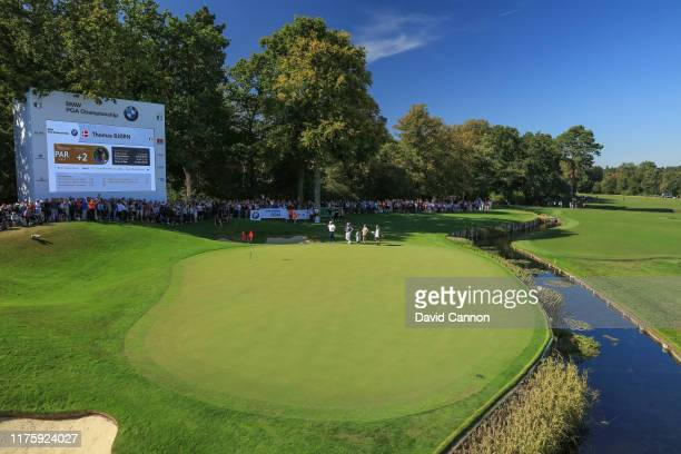 Danny Willett of England plays his third shot on the 18th hole during the second round of the BMW PGA Championship on the West Course at the...