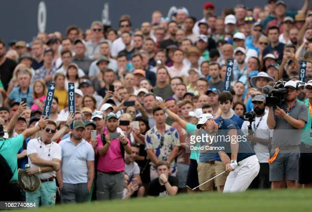 Danny Willett of England plays his third shot on the par 5, 18th hole during the third round of the DP World Tour Championship on the Earth Course at...
