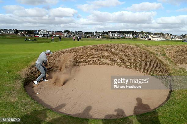 Danny Willett of England plays out of the bunker on the 16th hole during the first round of the Alfred Dunhill Links Championship on the Championship...