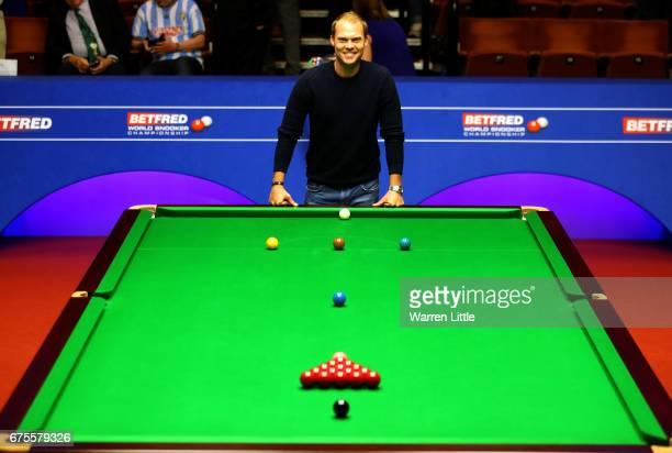 Danny Willett of England poses for a picture as he watches the final between Mark Selby of England and John Higgins of Scotland of the World Snooker...