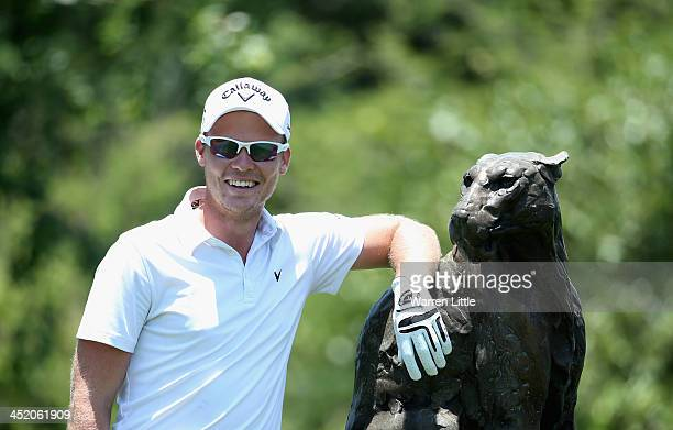 Danny Willett of England poses with a Leopard statue during the Proam ahead of the Alfred Dunhill Championship at Leopard Creek Country Club on...