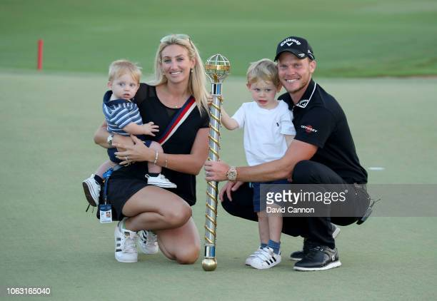 Danny Willett of England poses with his wife Nicole and his two sons Zach and Noah and the DP World Tour Championship Trophy after his two shot win...