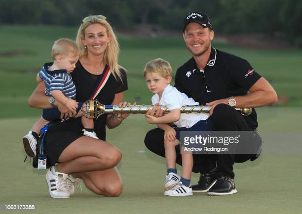 Danny Willett of England poses with his wife Nicole Willett after winning the DP World Tour Championship at Jumeirah Golf Estates on November 18,...