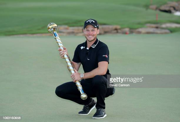 Danny Willett of England poses with the DP World Tour Championship Trophy after his two shot win during the final round of the DP World Tour...