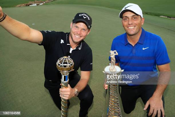 Danny Willett of England poses with the DP World Tour trophy alongside Francesco Molinari of Italy posing with the Race to Dubai trophy following the...