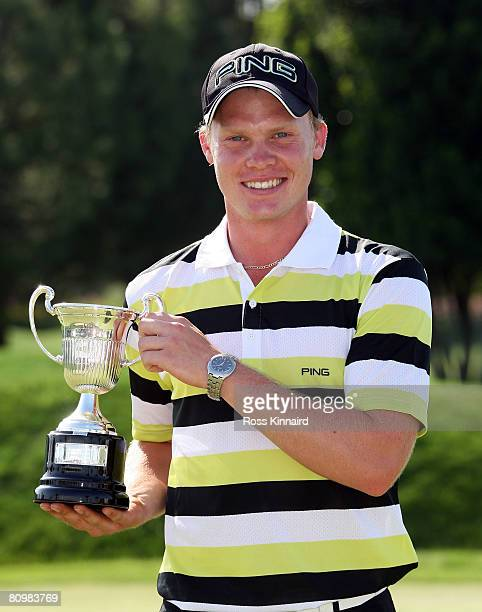 Danny Willett of England poses with the leading amateur trophy after the final round of the Open de Espana at the Real Club de Golf de Sevilla on May...