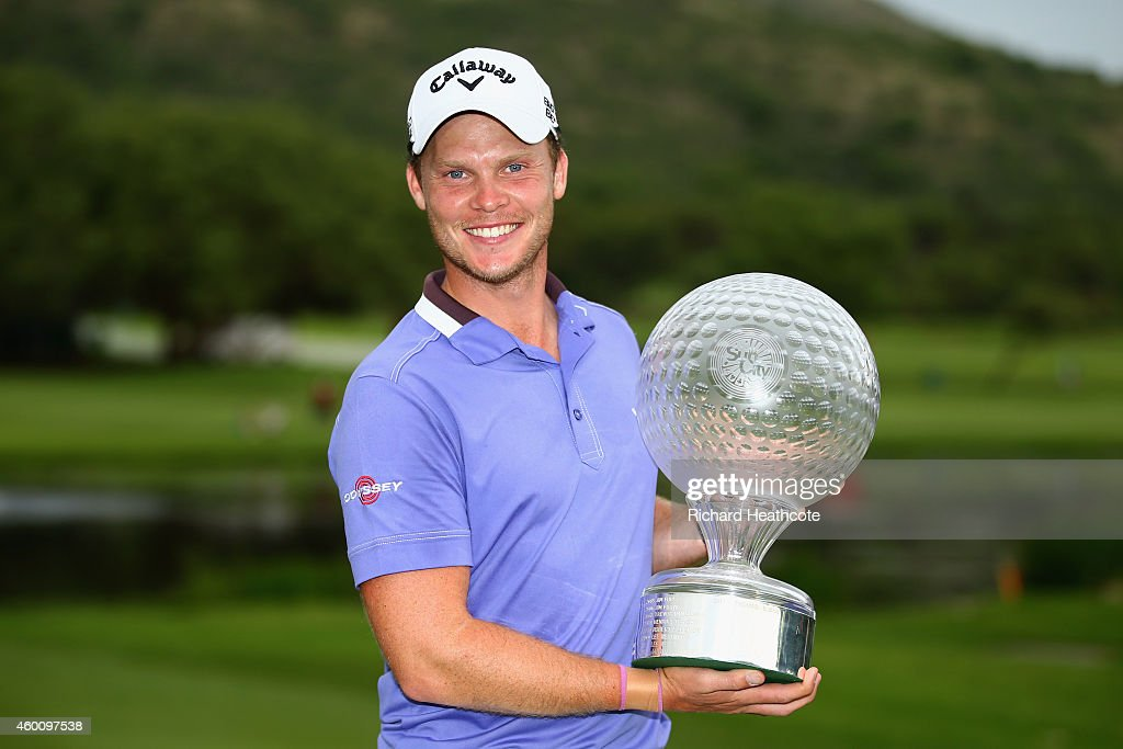 Danny Willett of England poses with the trophy after securing victory during the final round of the Nedbank Golf Challenge at the Gary Player Country Club on December 7, 2014 in Sun City, South Africa.